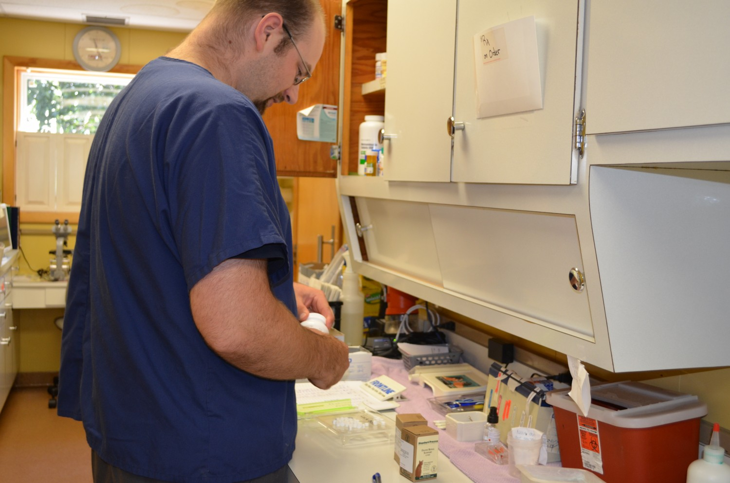 Technician Chris filling prescriptions - Manchester Veterinary Clinic - CT
